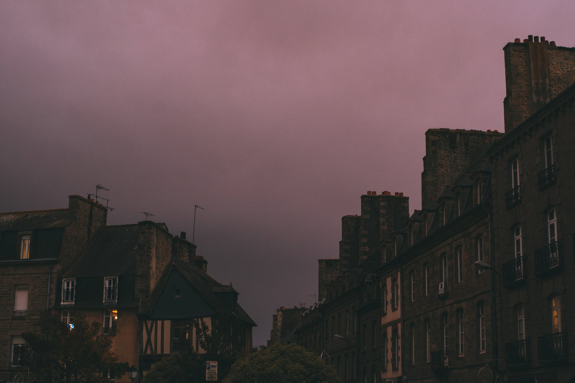 town street under dark purple sunset cloudy sky