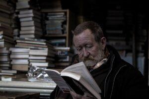 man-reading-alone