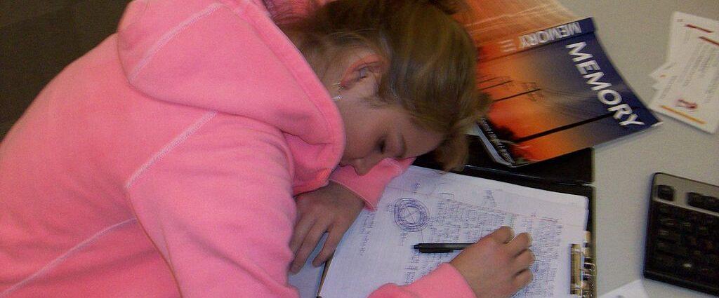 Teenager Sleeping While Studying